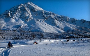 Snowmobiles snowy mountain travel